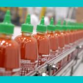 Full Sriracha bottles